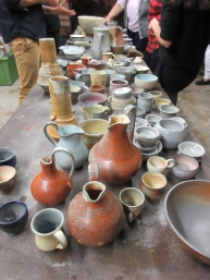 A pottery table full of beautiful creations